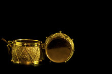 Christmas Ornaments With Golden Drum Shape On Black Background
