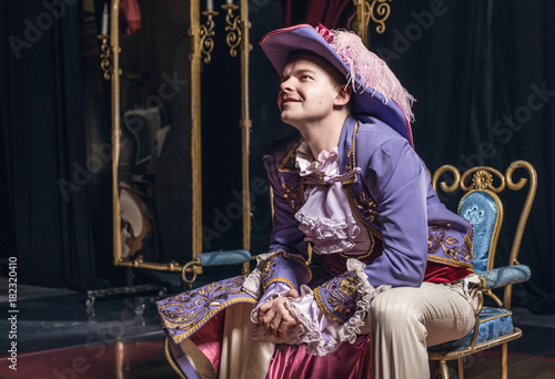 Plakát  Actor dressed historical costume in interior of old theater.