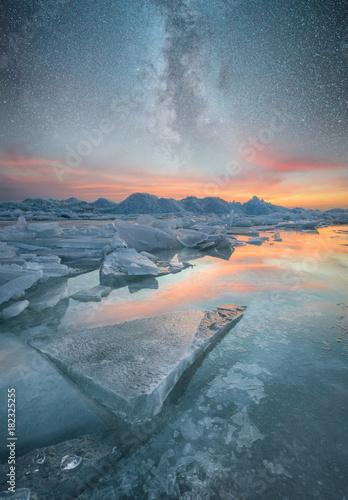 Fotografie, Obraz  Frozen sea and night sky with stars