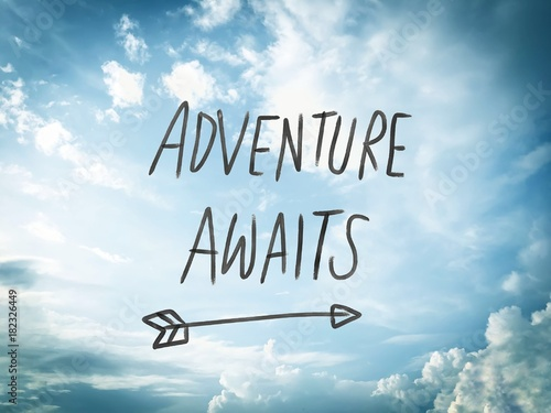 Adventure awaits word on blue sky and cloud background Canvas Print