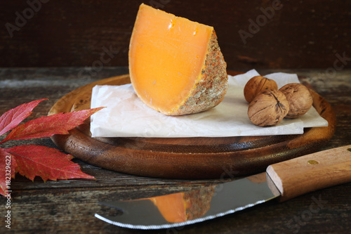 Staande foto Zuivelproducten Mimolette cheese and walnuts