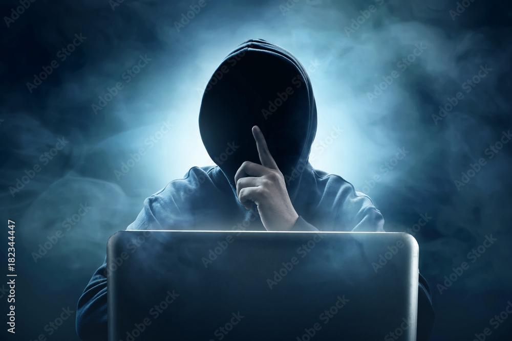 Fototapeta Hacker using laptop