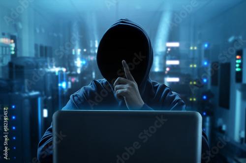 Fototapety, obrazy: Hacker using laptop