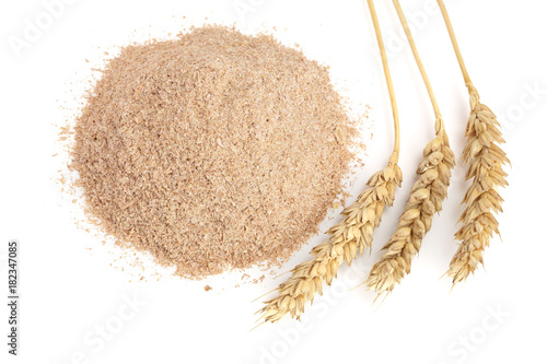 Fotografia, Obraz  Pile of wheat bran with ears isolated on white background