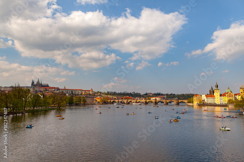 Wall Murals Temple View on the river Vltava with boats. Old town of Prague, Czech Republic, summer season.