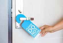 Woman Hand Holding Signboard D...