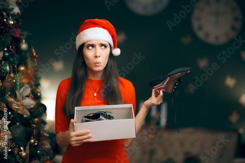 Fotografie, Tablou Sad Woman Hating Receiving Flat Shoes as Christmas Present