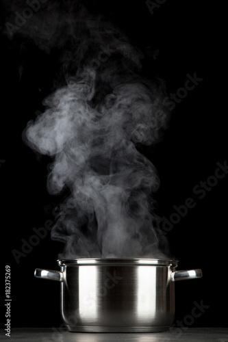 Fototapeta Steaming pot on black background obraz