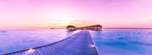 Sunset On Maldives Island, Water Villas Resort. Beautiful Sky And Clouds. Beautiful Beach Background For Summer Travel With Sun, Beach Wooden Jetty. Summer Mood Sun Beach Background Concept.