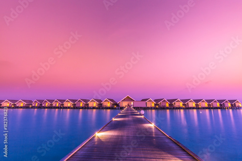 Sunset on Maldives island, water villas resort Canvas Print