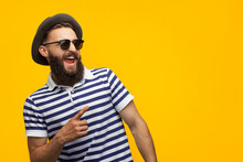 Stylish Hipster Man Pointing A...
