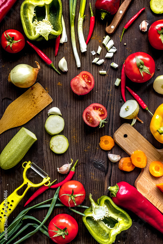 Tuinposter Groenten ingredients for vegetable ragout on wooden background top view