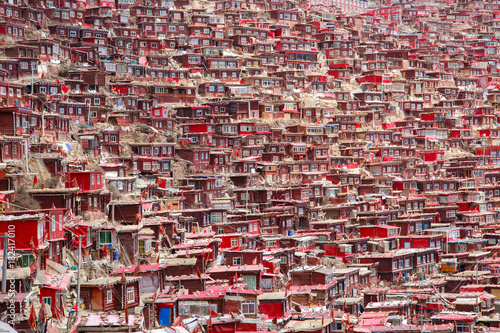 Red monastery and home at Larung gar (Buddhist Academy) in sunshine day and background is blue sky, Sichuan, China Canvas Print