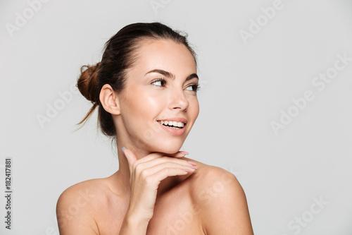 Fotografia  Beauty portrait of a young beautiful half naked woman
