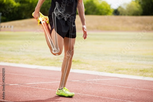 Obraz na plátne Highlighted bones of athlete man stretching on race track