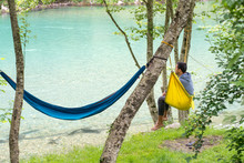 Man Relax In A Hammock Overlo...