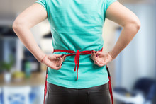Woman Tie A Back Knot Of Red Apron