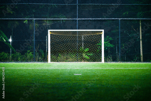 Indoor Football (soccer) Field with the Goal Post in the Night Time