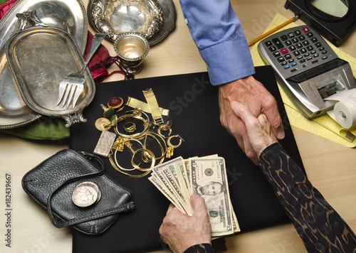 Fototapeta woman selling gold and silver obraz