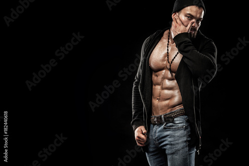 Vászonkép Handsome fit man posing wearing in jeans with tattoo