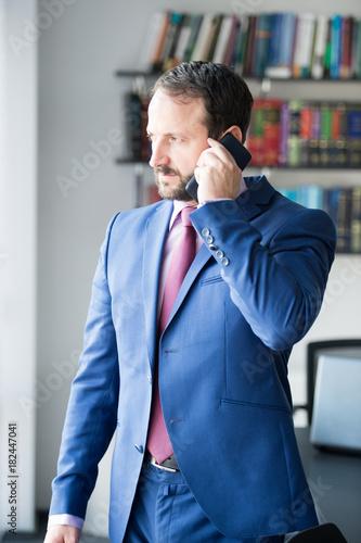 Fototapety, obrazy: Businessman man talk on mobile phone