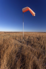 Orange Windsock On Abandoned Airstrip On Kansas Prairie