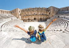 Two Young Girls Student Traveler Enjoy A Tour Of The Ancient Greek Amphitheater