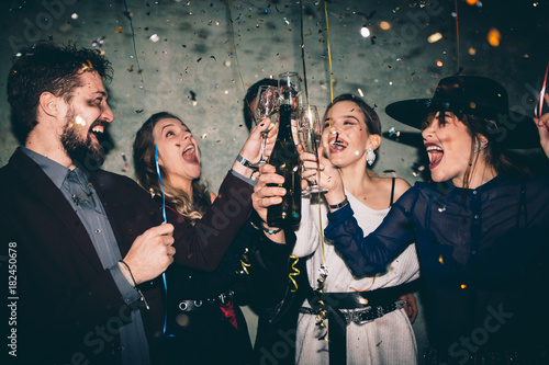 Group of happy friends drinking champagne and celebrating New Year Tapéta, Fotótapéta