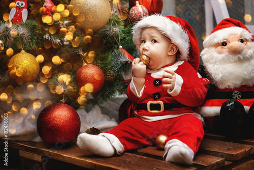 580b52ddc236 Portrait Caucasian baby boy with gray eyes in red Santa Claus ...