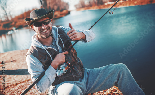 Photo Angler enjoys in fishing on the river