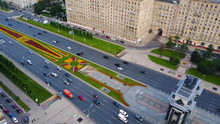 Aerial View On Triumphal Arch, Victory Park In Moscow. Along Triumphal Arch On Kutuzov Avenue Moving Cars And Pedestrians