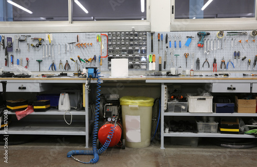 Obraz workshop with large workbench and a large number of tools for ma - fototapety do salonu