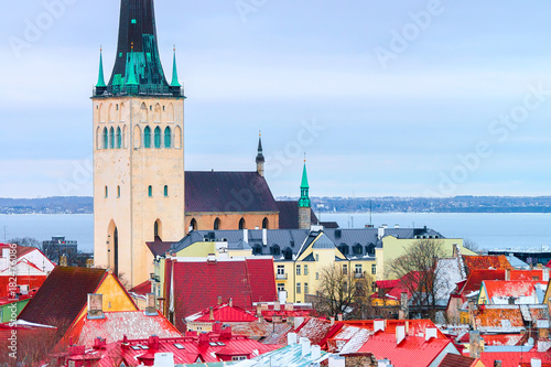 Cityscape and St Olaf Church in Old town of Tallinn Poster