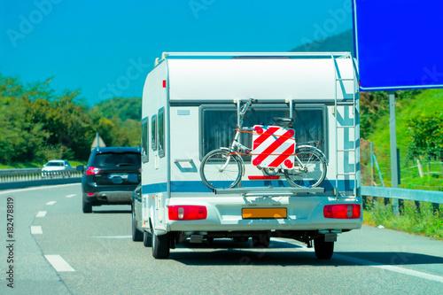 Foto op Aluminium Pixel Caravan with bicycle on highway in Switzerland