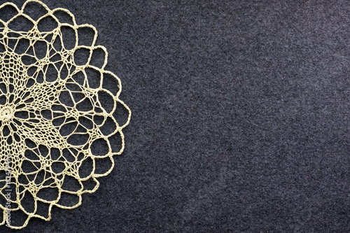Vászonkép  Beautiful delicate vintage background of crochet napkin on the dark felt canvas