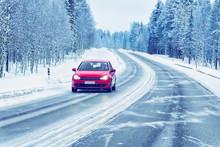 Red Car In Road In Winter Rova...