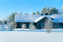 Cottage House At Winter Countryside In Lapland Sunny Day