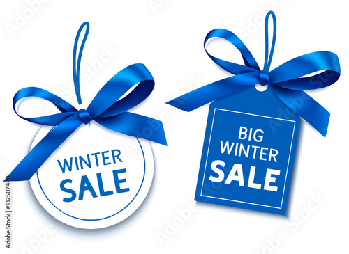 Fototapeta Winter sale tag with blue bow for your design. Vector set of discount labels obraz