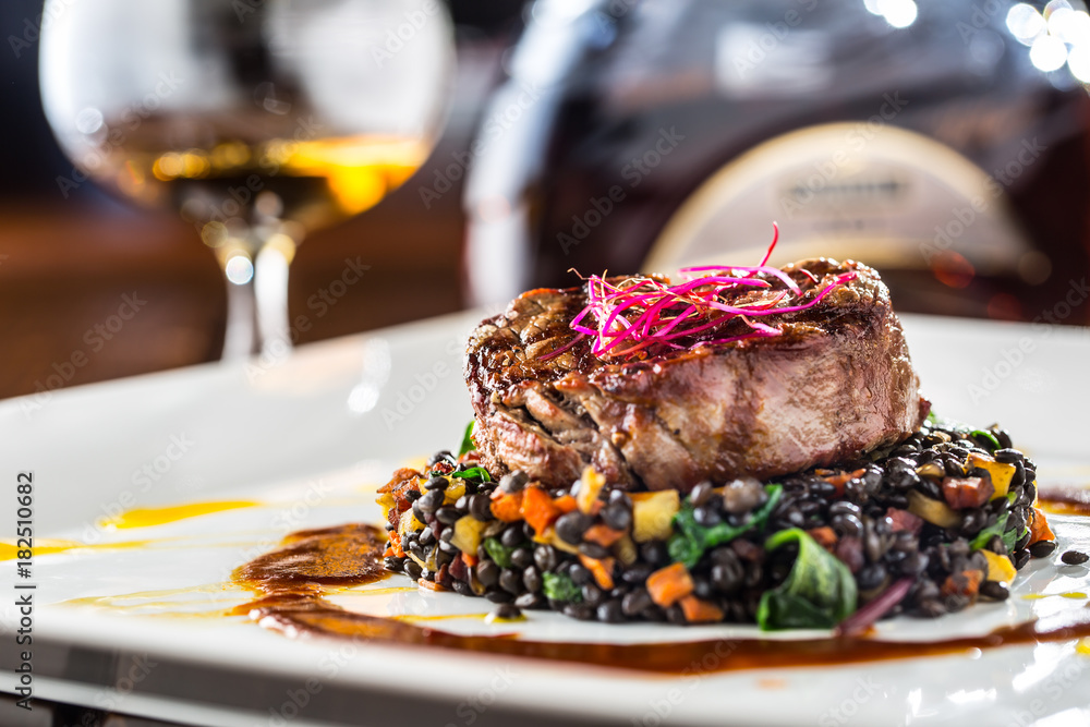 Fototapety, obrazy: Beef Steak. Grill beef steak black lentils mixed with vegetable. Cognac or brandy as drink. Culinary food in hotel pub or restaurant