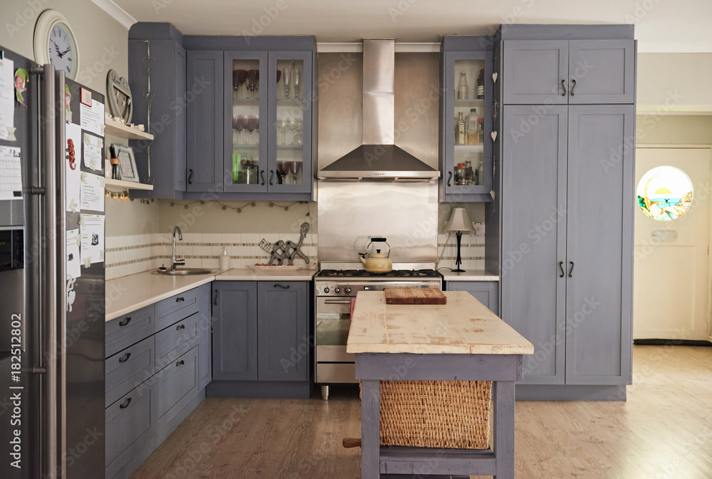 Fototapety, obrazy: Country style kitchen with modern appliances in a contemporary home