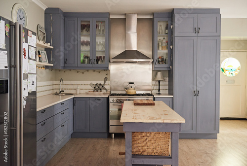 Αφίσα  Country style kitchen with modern appliances in a contemporary home