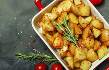 Baked Potatoes With Spices And...