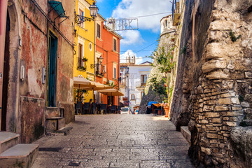 Fototapeta colorful south italy village alley in Apulia in the town of Vico del Gargano