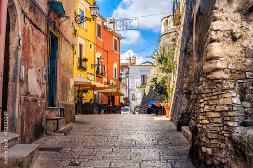 Fotografie, Obraz  colorful south italy village alley in Apulia in the town of Vico del Gargano
