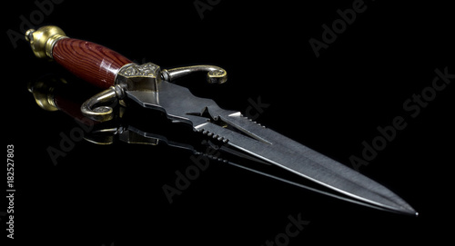Photo dagger on black background