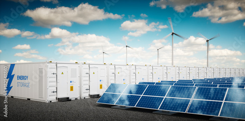 Obraz Concept of energy storage system. Renewable energy power plants - photovoltaics, wind turbine farm and  battery container. 3d rendering. - fototapety do salonu