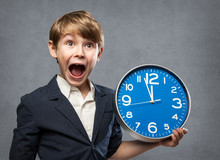 Happy Surprised 7 Year Old Boy, Holding A Blue Big Clock, Just Minutes Before Midnight: Either, He Is Warning Us That Time Is Running Out, Or Ready To Celebrate New Year
