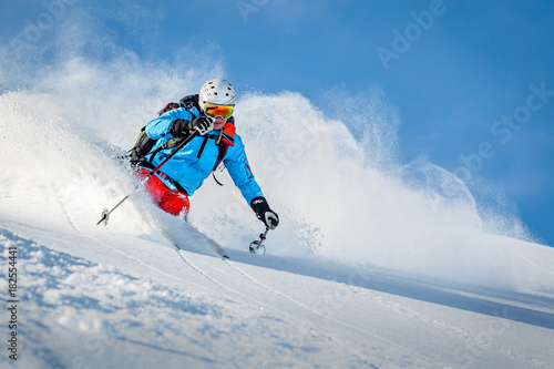 Fotografering Male freeride skier in the mountains off-piste