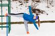 Woman wearing sportswear urban exercising outside during winter