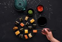 Set Of Sushi Maki And Rolls On Black Background